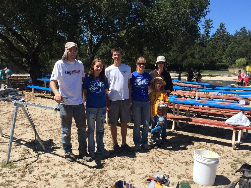 The Kvamme Family working as part of the boys' Eagle Scout project on repairing and prettying our picnic tables!